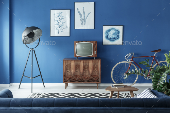 TV, bike and lamp in living room - Stock Photo - Images