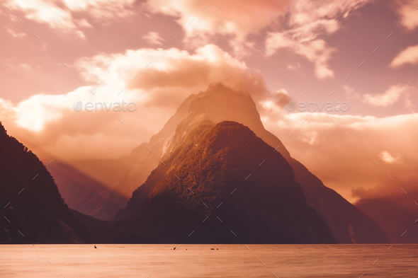 Scenic view of Milford sound peak at sunset, New Zealand - Stock Photo - Images