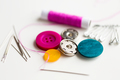sewing buttons, needles, pins and thread spool