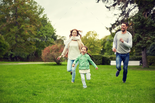 happy family walking in summer park - Stock Photo - Images