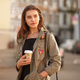 youth pretty female with coffee on street - PhotoDune Item for Sale