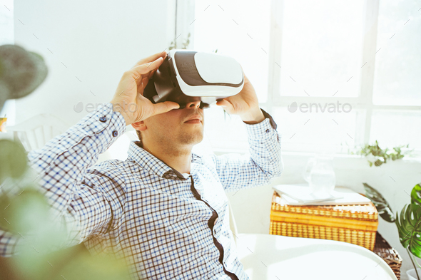 The man with glasses of virtual reality. Future technology concept. - Stock Photo - Images