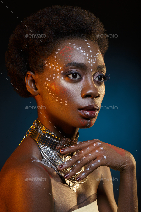 Beautiful afro girl with drawings on skin - Stock Photo - Images