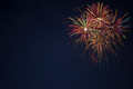 Golden red green fireworks over night sky - PhotoDune Item for Sale
