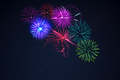 Pink purpe blue green fireworks over starry sky - PhotoDune Item for Sale