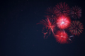 Red  fireworks located right side over night sky - PhotoDune Item for Sale
