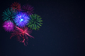 Pink purpe blue green fireworks over night sky - PhotoDune Item for Sale
