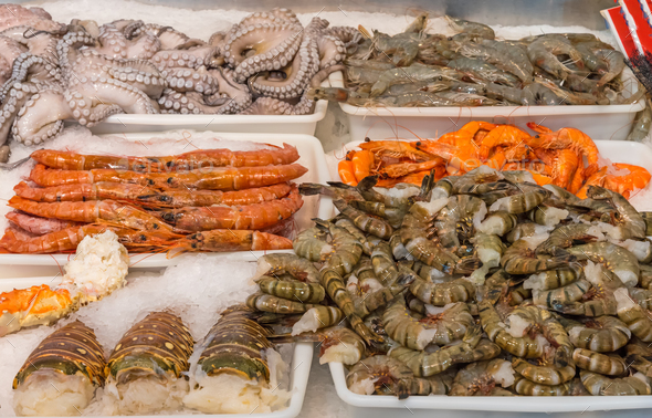 Shellfish and seafood at a market - Stock Photo - Images