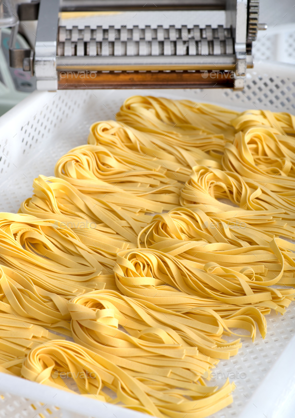 Freshly made Italian fettuccine pasta on a tray - Stock Photo - Images