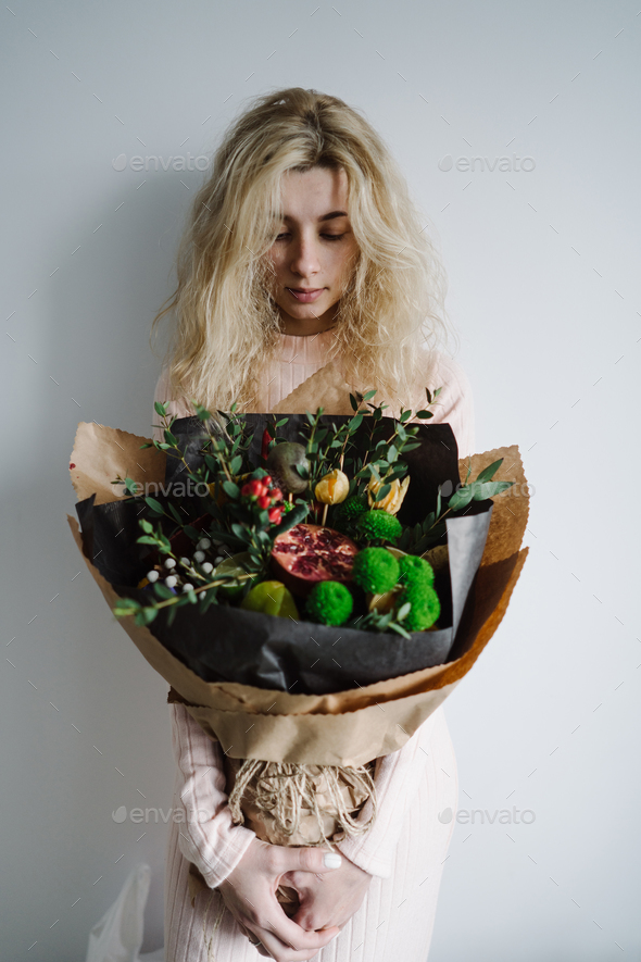 portrait of a girl with a bouquet - Stock Photo - Images