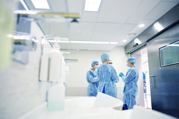 group of surgeons in operating room at hospital - Stock Photo - Images