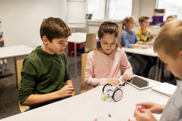 happy children building robots at robotics school - Stock Photo - Images