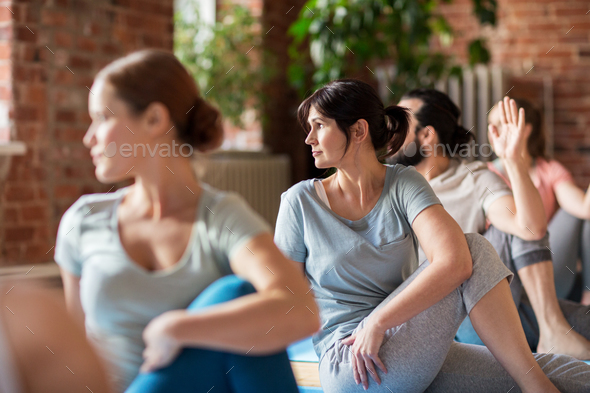 group of people doing yoga exercises at studio - Stock Photo - Images