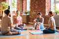 group of people resting on yoga mats at studio - PhotoDune Item for Sale