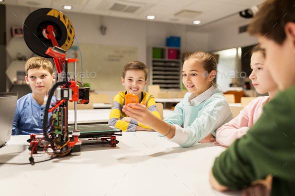 happy children with 3d printer at robotics school - Stock Photo - Images