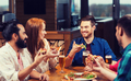 friends eating pizza with beer at restaurant - PhotoDune Item for Sale