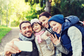 family with backpacks taking selfie by smartphone - PhotoDune Item for Sale