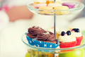 close up of cake stand with cupcakes and cookies - PhotoDune Item for Sale
