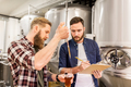 men with pipette testing craft beer at brewery - PhotoDune Item for Sale
