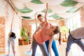 group of people doing yoga exercises at studio - PhotoDune Item for Sale