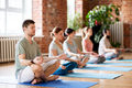 group of people making yoga exercises at studio - PhotoDune Item for Sale