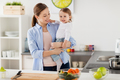 happy mother and little baby girl at home kitchen - PhotoDune Item for Sale