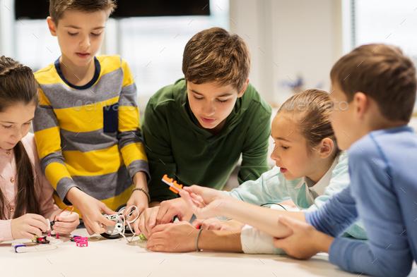 happy children building robots at robotics school - Stock Photo - Images