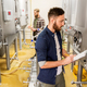 men with clipboard at craft brewery or beer plant - PhotoDune Item for Sale