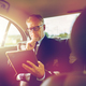 senior businessman with tablet pc driving in car - PhotoDune Item for Sale