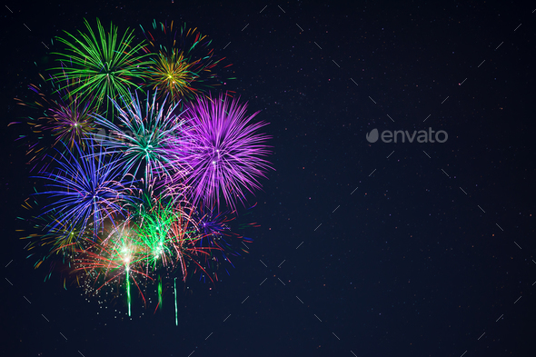 Beautiful gree purple blue red fireworks copy space - Stock Photo - Images