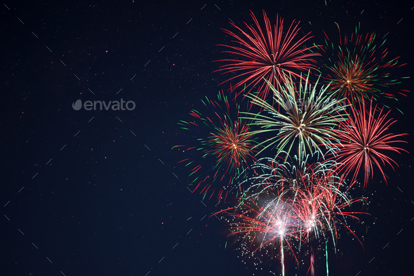 Sparkling red green yellow fireworks - Stock Photo - Images