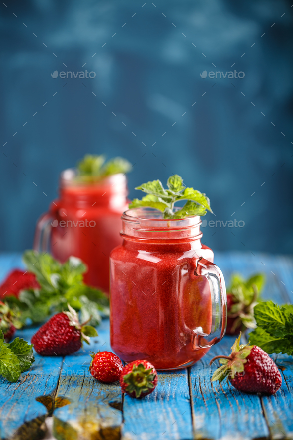 Strawberry smoothie in jars - Stock Photo - Images
