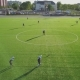 Aerial Shooting with a Drone As Players Play Football on the Field