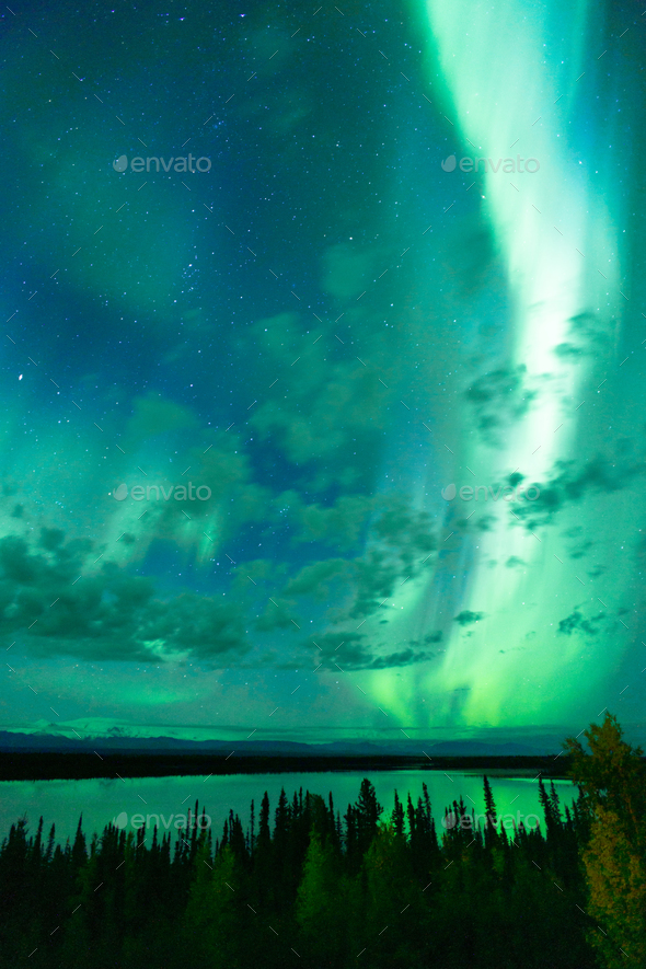 Lake Reflects Aurora Borealis Emerging Through Clouds Remote Alaska - Stock Photo - Images