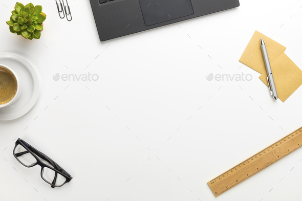 Top view of modern white office desk with notebook and supplies - Stock Photo - Images