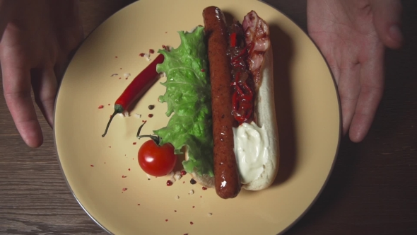 VideoHive Delicious Hot Dog on the Plate Fast Food Meal Home Cooking Roasted Sausage in a Bun with Chili 20204348