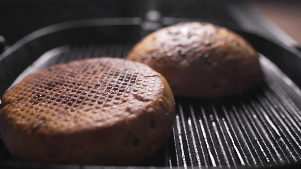 VideoHive Roasting Crispy Buns for Burgers Making Hamburger Fast Food Cooking at Home Buns Is Grilled 20204946