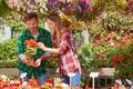 People watching flowers in garden - PhotoDune Item for Sale