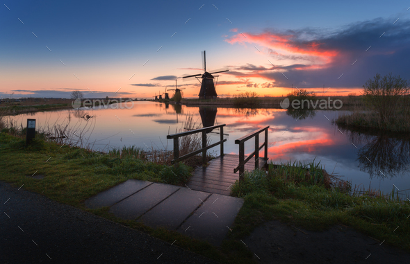 Silhouette of windmills at sunrise in Kinderdijk, Netherlands - Stock Photo - Images