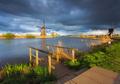 Windmills at sunset in Kinderdijk, Netherlands. Rustic landscape