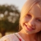 Portrait Adorable Little Girl Smiles Outdoor at Sunset - VideoHive Item for Sale