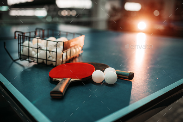 Ping pong table, rackets and balls in a sport hall - Stock Photo - Images