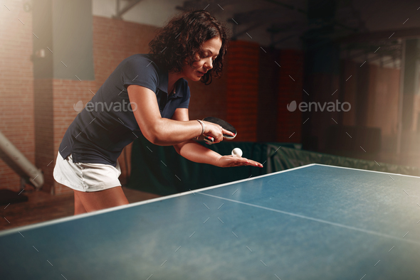 Table tennis, female player with racket and ball - Stock Photo - Images