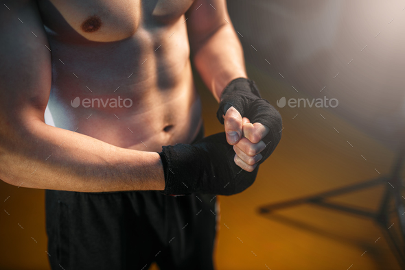 Muscular male person hands in black bandages - Stock Photo - Images