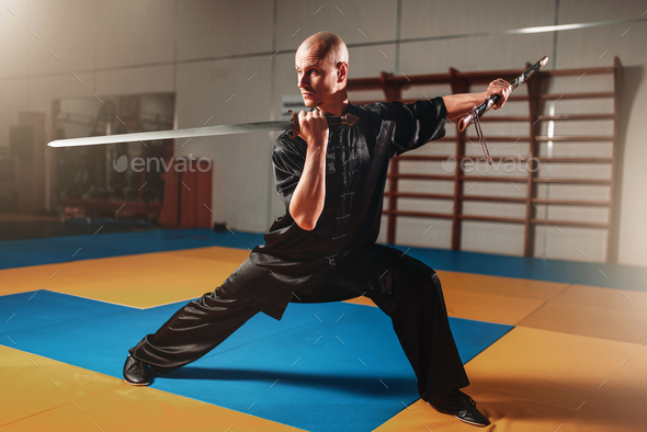 Wushu master training with sword, martial arts - Stock Photo - Images
