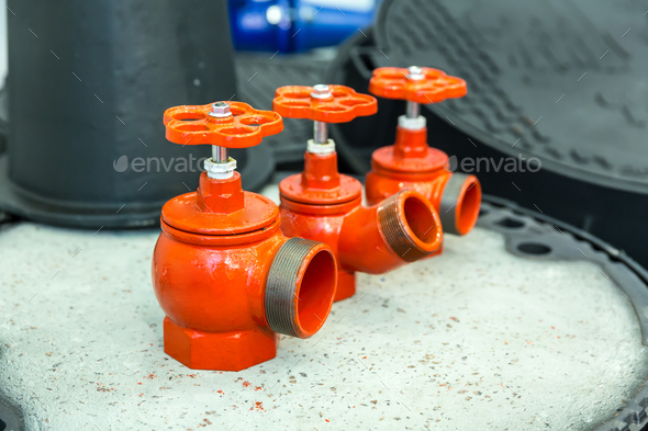 Red valves closeup, new pressure controllers - Stock Photo - Images