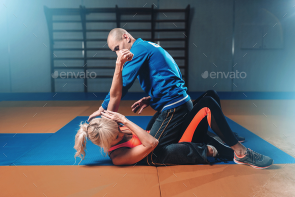 Woman fights with man, self-defense technique - Stock Photo - Images