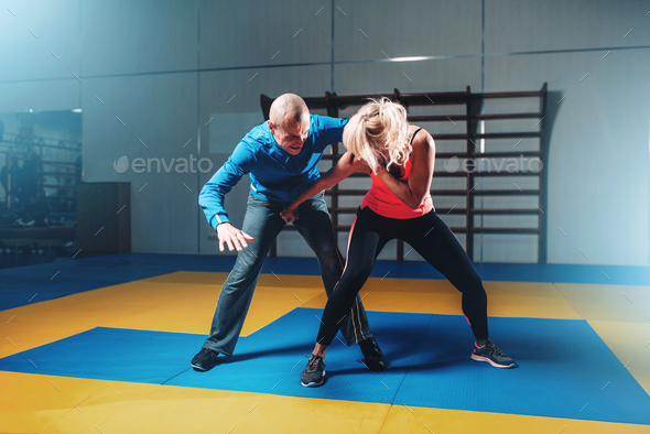 Woman fights with man, self defense technique - Stock Photo - Images