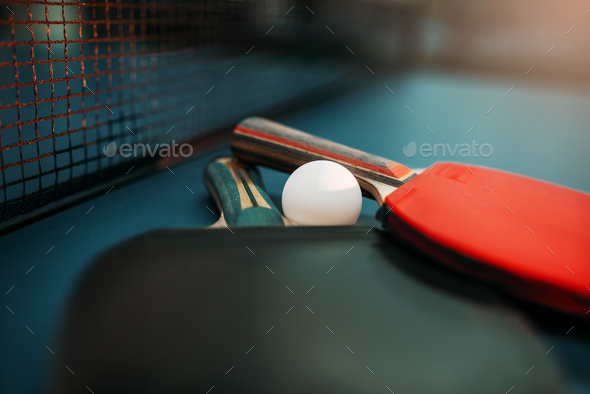 Tennis rackets and ball on the table, game concept - Stock Photo - Images