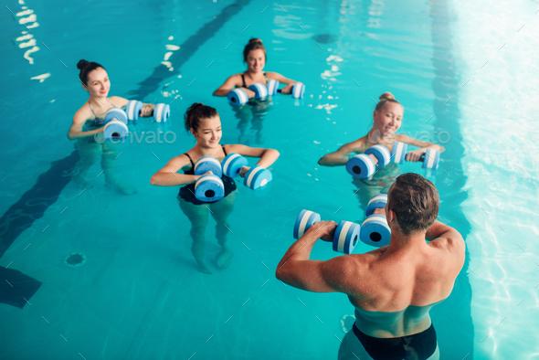Women aqua aerobics traninig with dumbbells - Stock Photo - Images